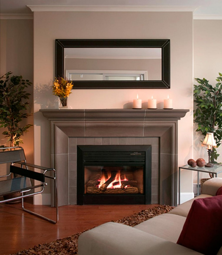 Fireplace Mantel Kits with rectangles mirror above and wooden floor for Modern World Decorating Ideas