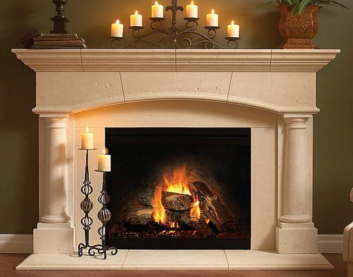 fireplace mantel kits with six chadels above and two below and green wall