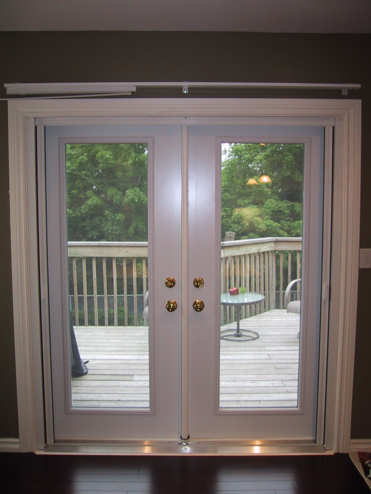 glass Retractable Screen doors with golden handle