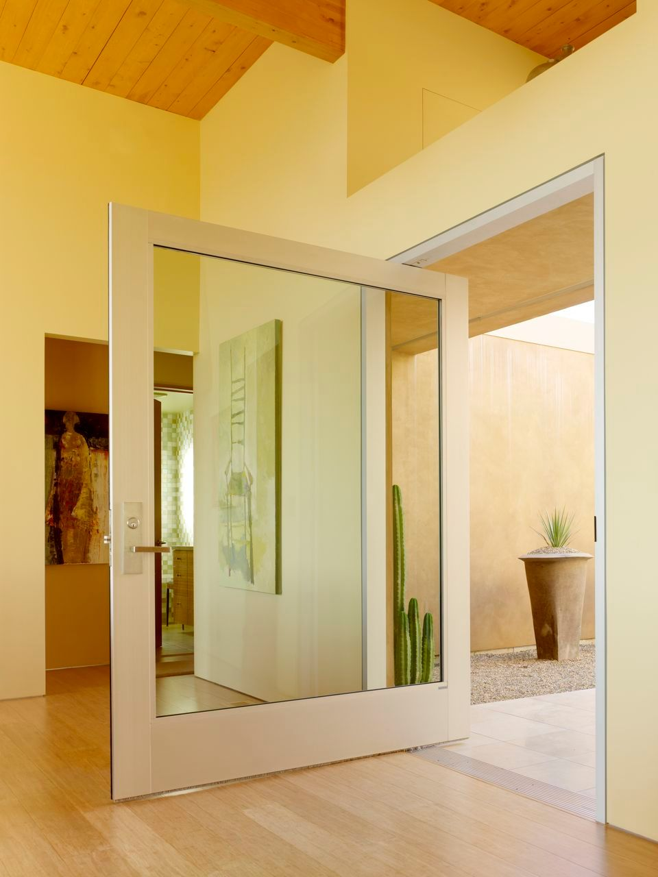 glassentry door with sidelights in modern design matched with white wall and ceramics floor