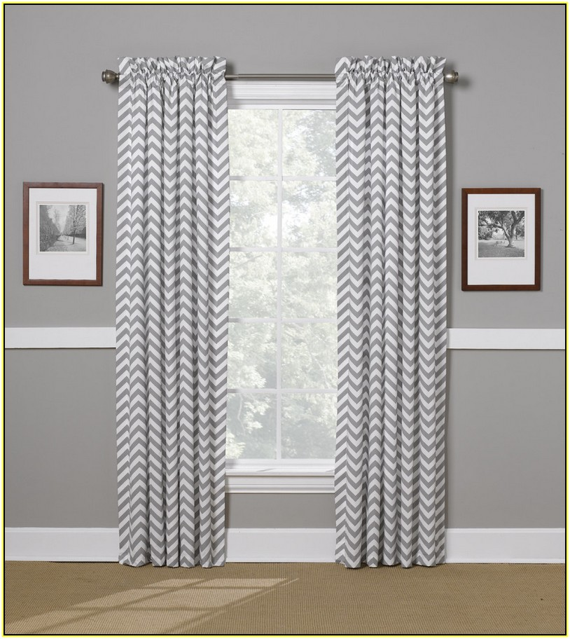 Gray Chevron Curtains with double picture on grey wall