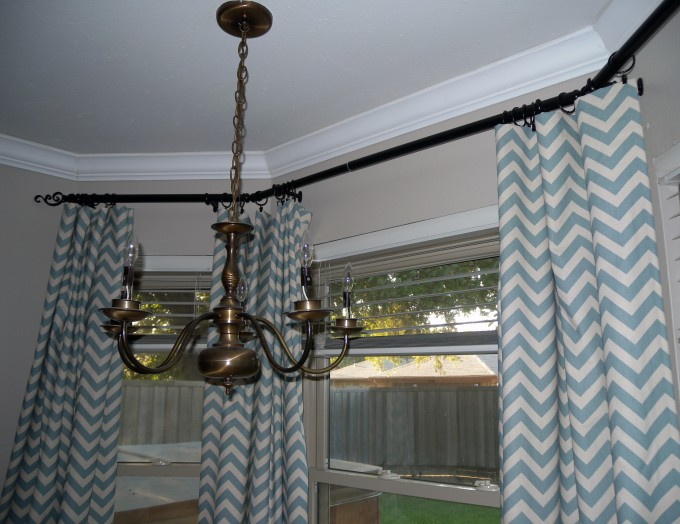 Grey And White Chevron Curtains Matched With Wheat Wall Plus Chandelier And Glass Window