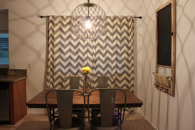 Grey Chevron Curtains For Window In Dining Room With Chandelier And Dining Table