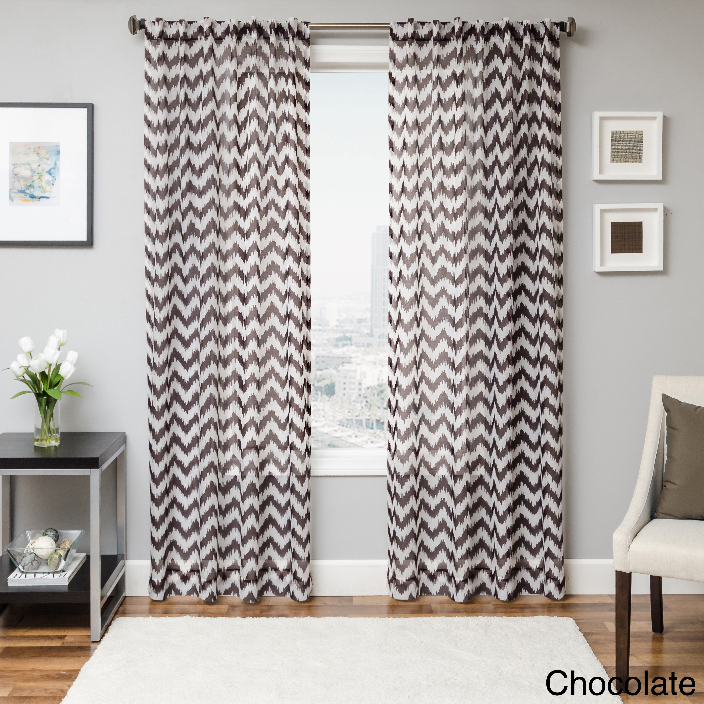 Grey Chevron Curtains matched with grey wall and pictures plus white sofa and white carpet
