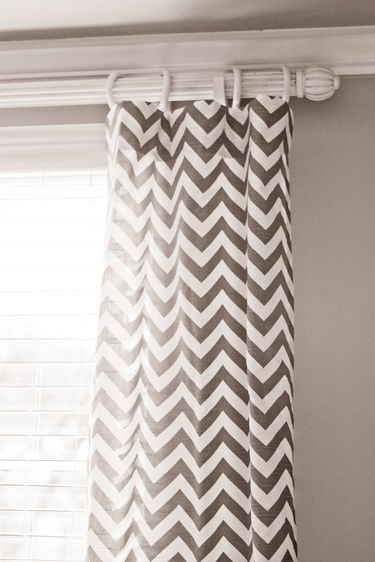grey chevron curtains with window and tan wall