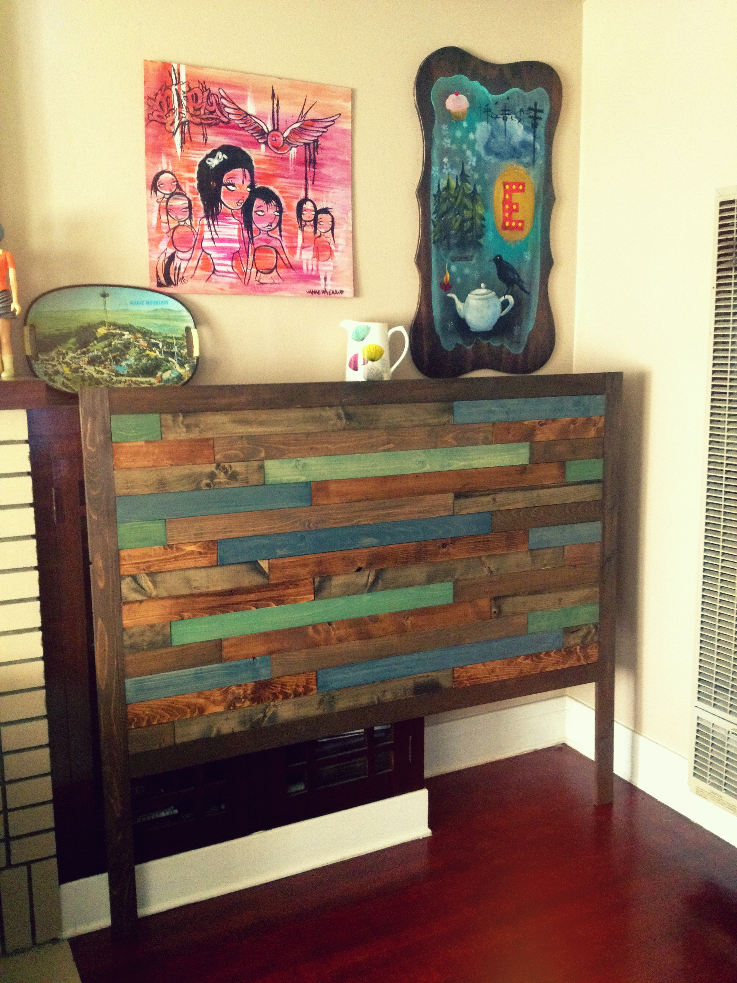 Homemade Headboards With Nice Pictures Above And Natural Brown Floor