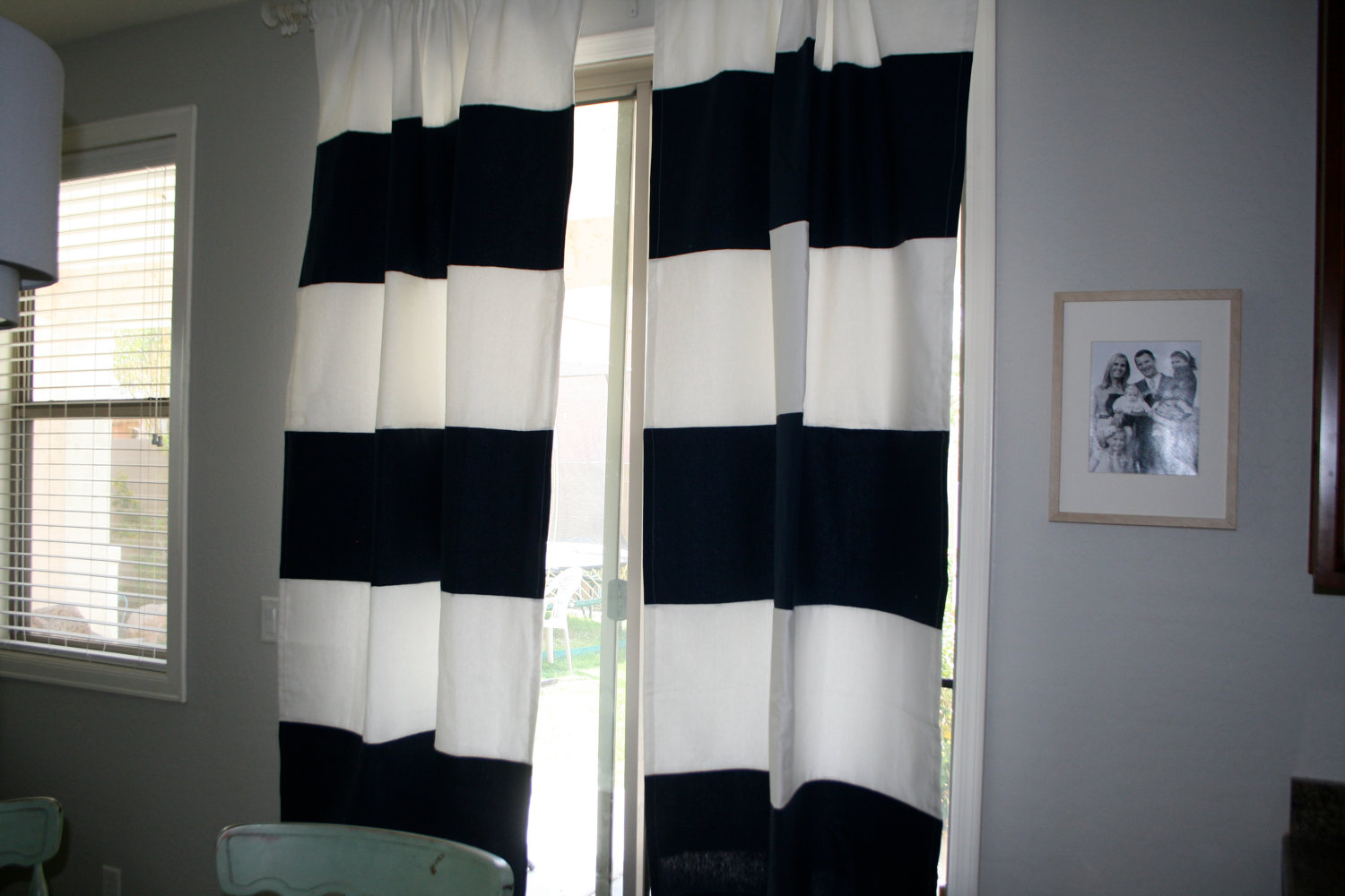 horizontal striped curtains for glass door matched with white wall