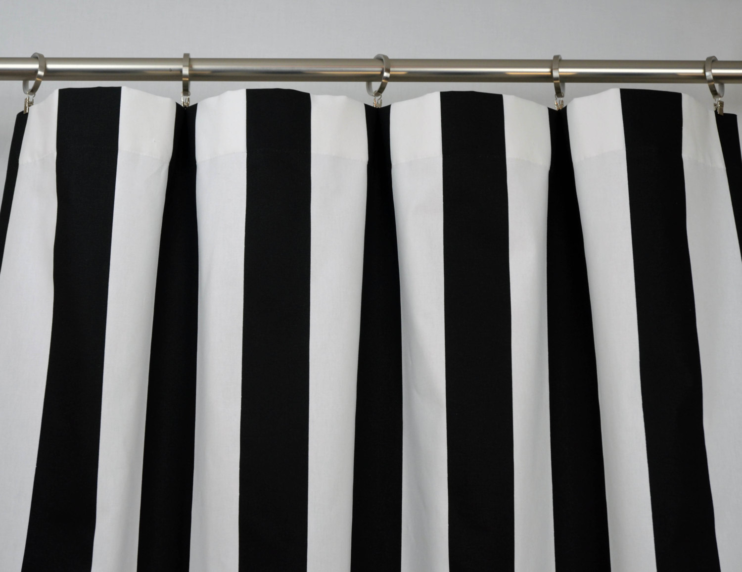 horizontal striped curtains in black and white with iron curtain rings