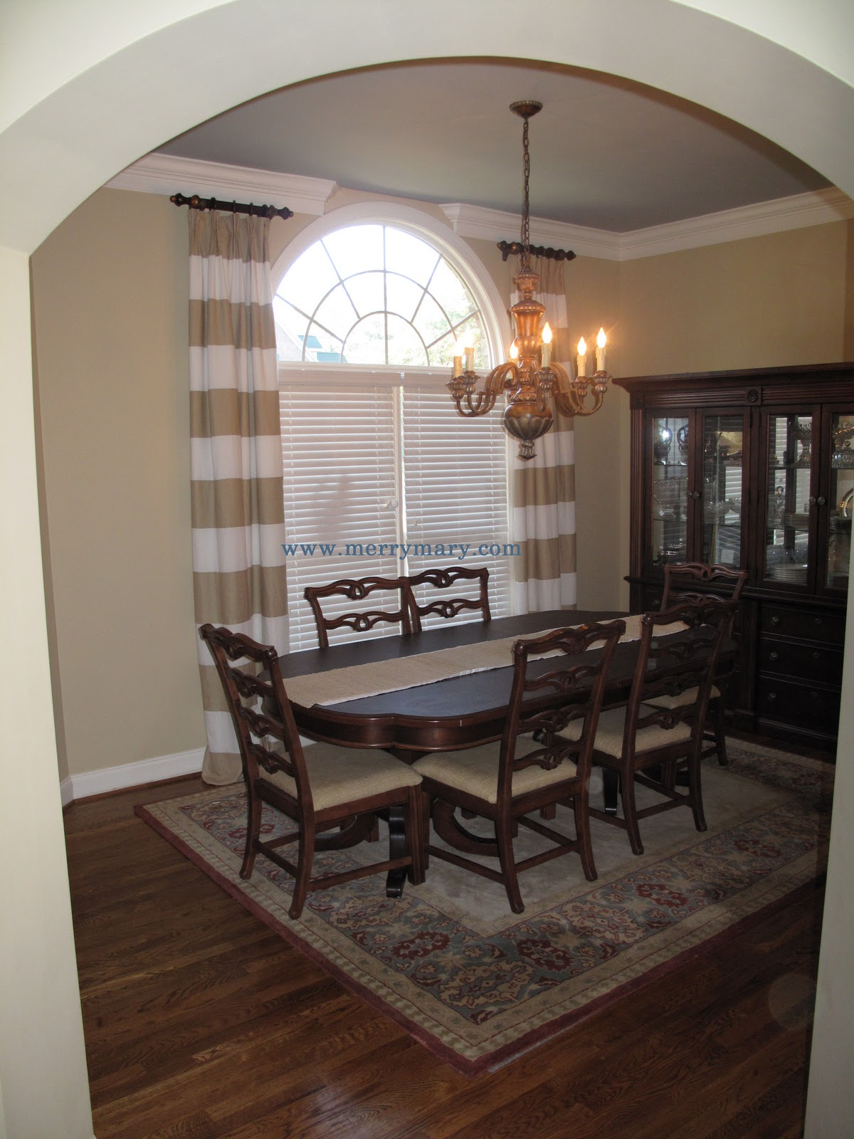 Horizontal Striped Curtains matched with arch window with chandelier and dining table for dining room ideas