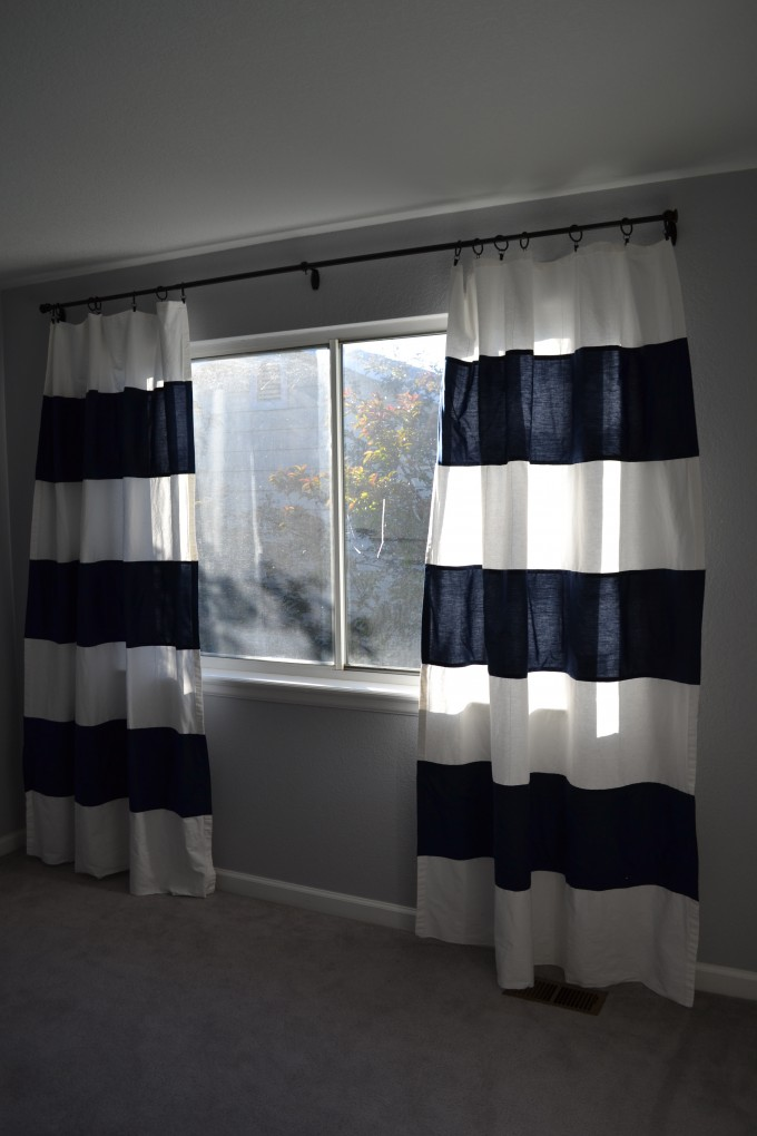 Horizontal Striped Curtains Matched With Horizontal Slider Window And Grey Wall