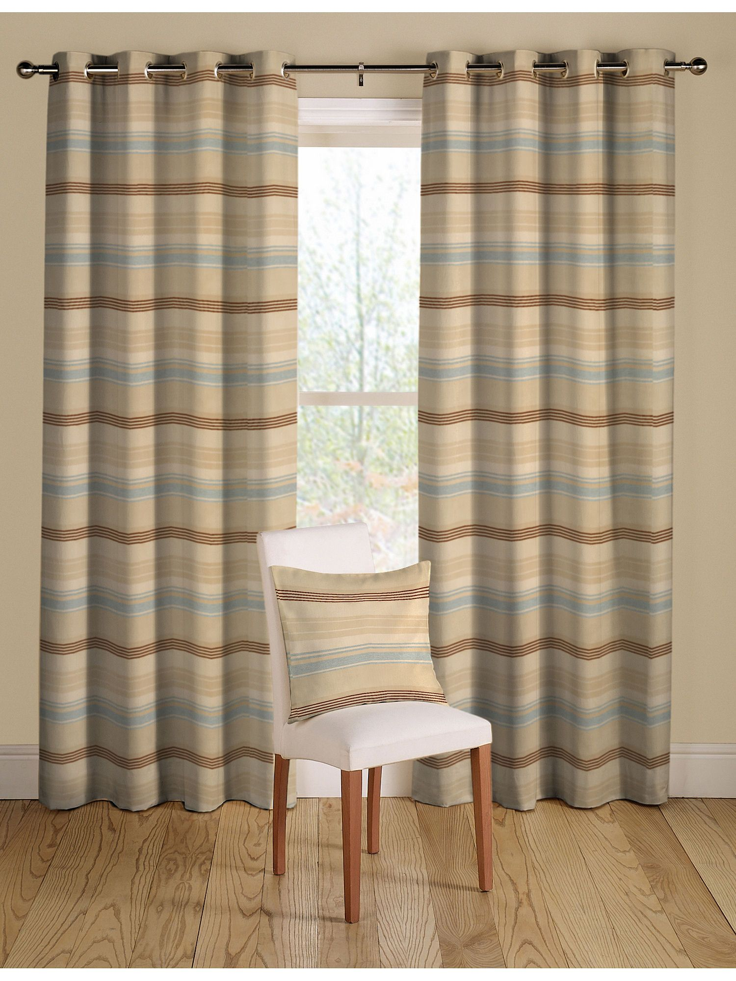 Horizontal Striped Curtains with matching pillow and chair and wooden floor