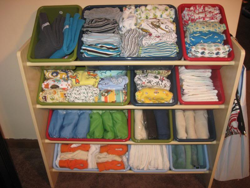 ikea toy storage filled with towels and kids clothes for furniture ideas