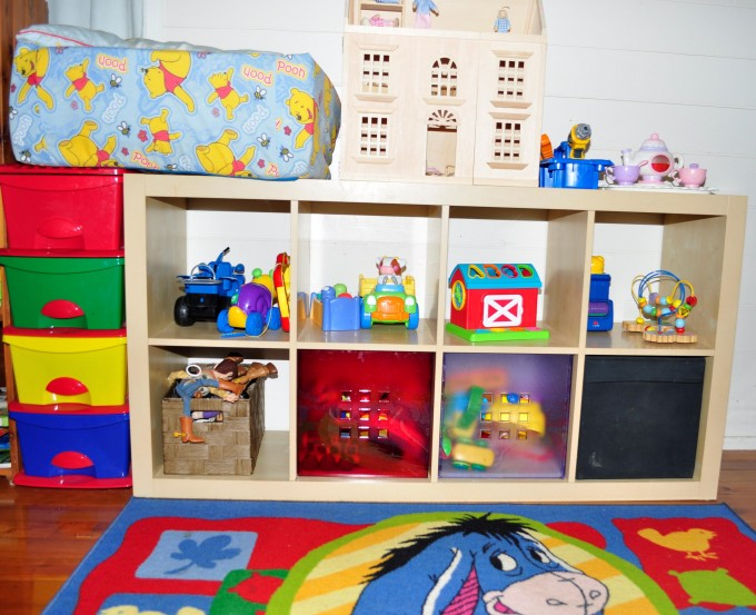 Ikea Toy Storage Filled With Toys And Mini Castle Toy Above With Character Carpet For Kids Decor Ideas