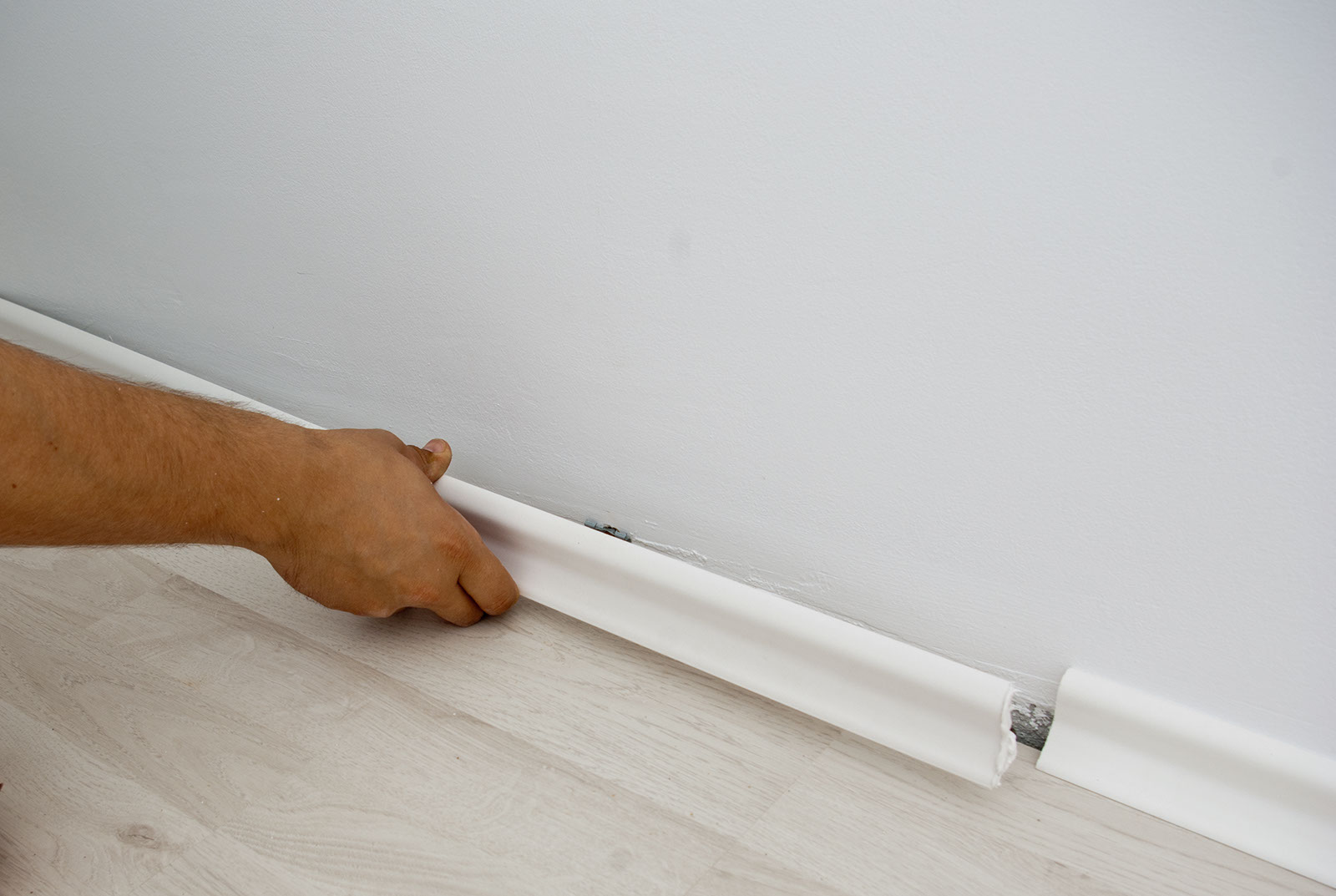 Installation Baseboard Molding On White Wall