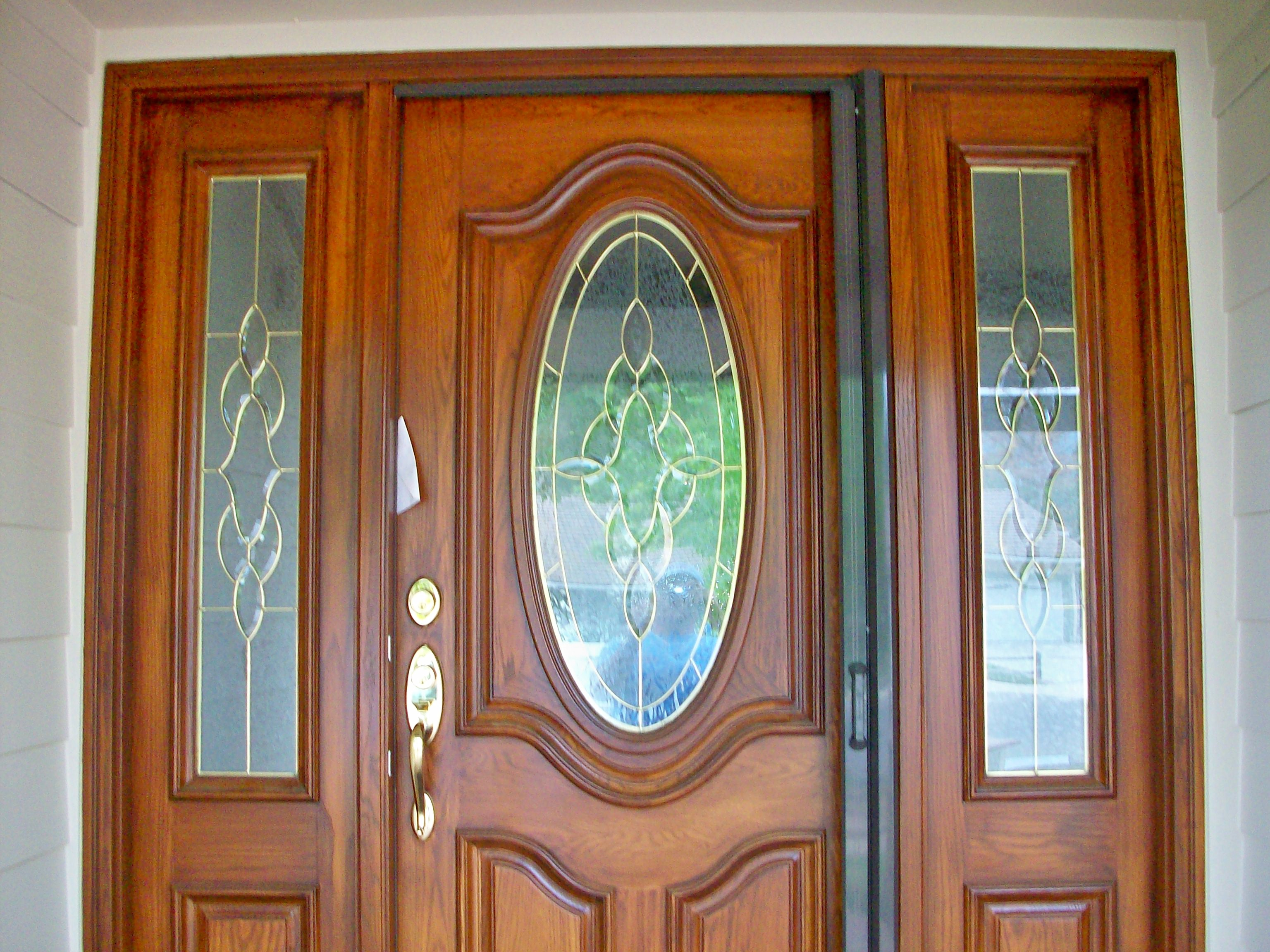 luxury Retractable Screen Doors with golden handle and ornament touching on glass