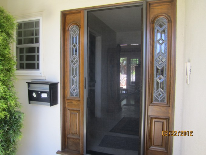 Luxury Wooden Retractable Screen Doors With White Wall And Mailbox