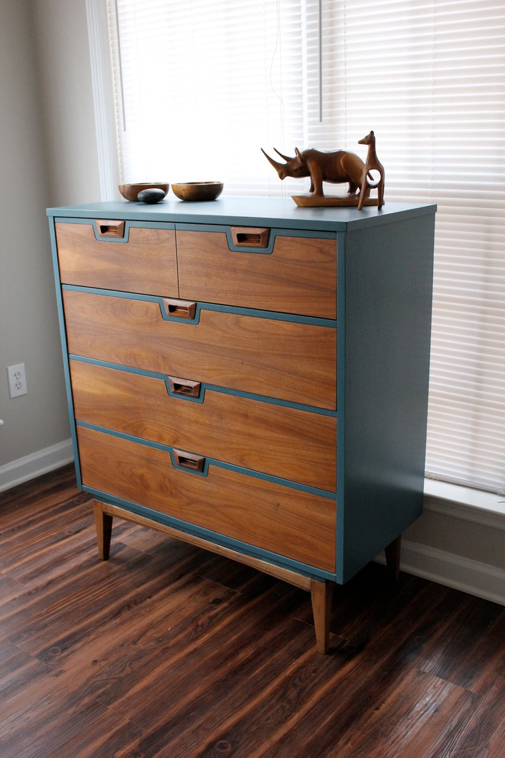Mid Century dresser in modern design with blue and brown color on wooden floor