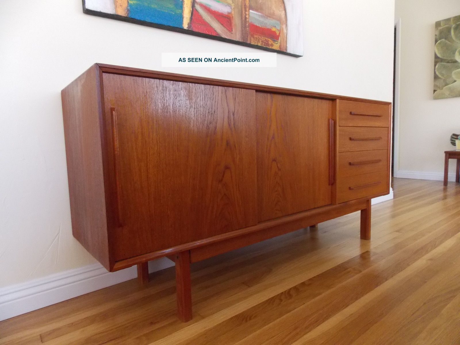 Mid Century Dresser with sideboard dufet display case before white wall