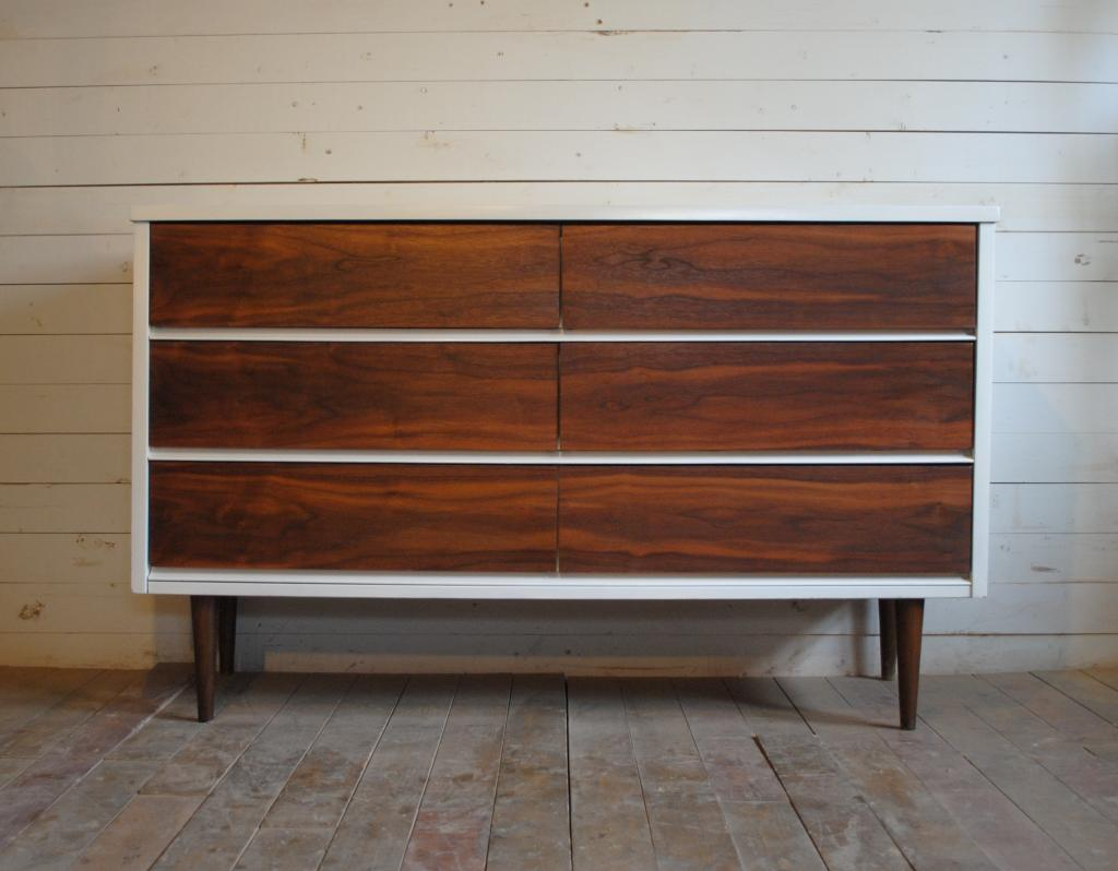 Mid Century Dresser with six drawers and silver list on wooden floor