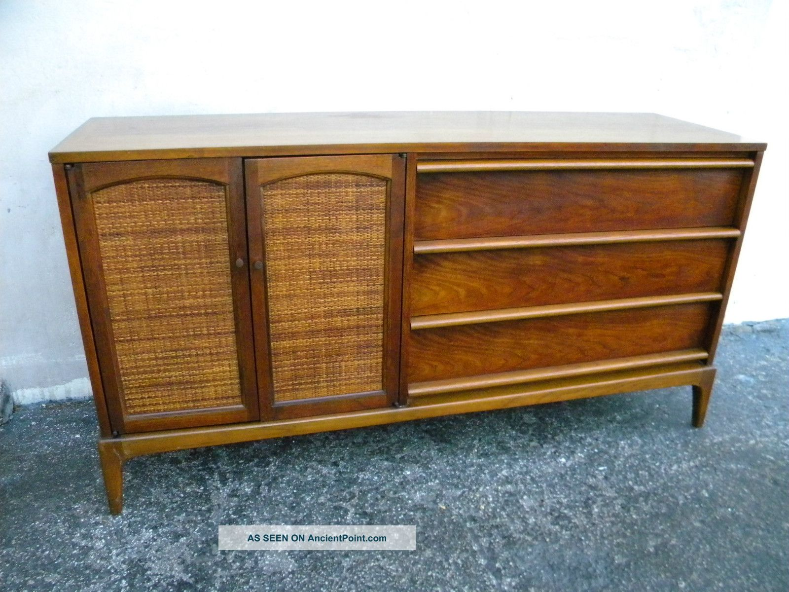 Mid Century Dresser with storage before white wall on ceramic floor