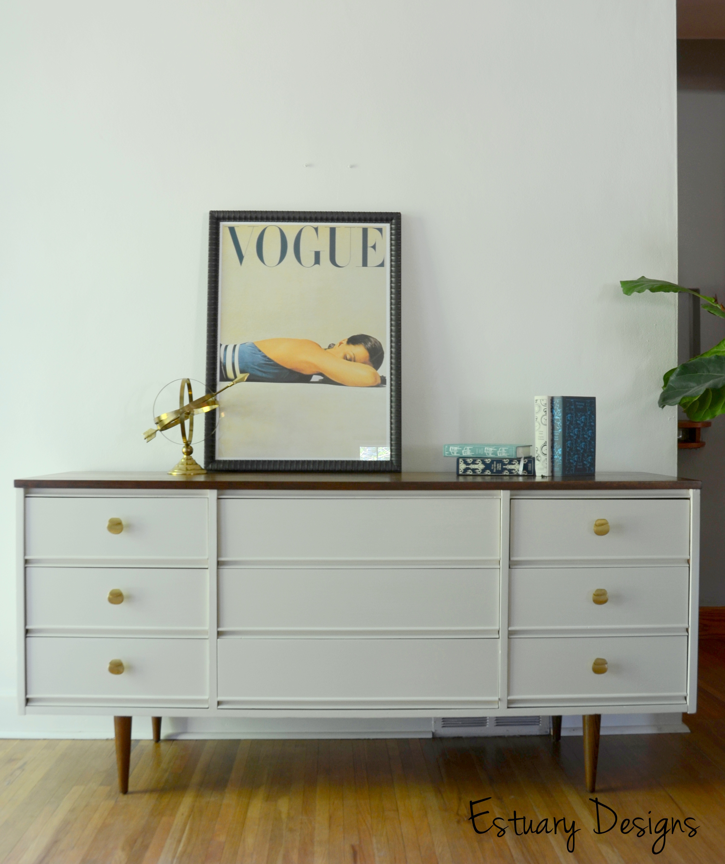 modern Mid Century Dresser in white nuance with picture and book above