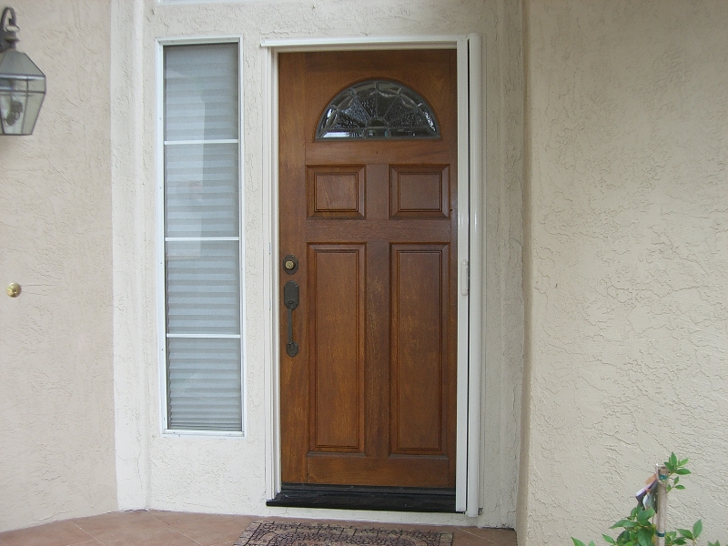 modern Retractable screen doors with arch ornament and white wall