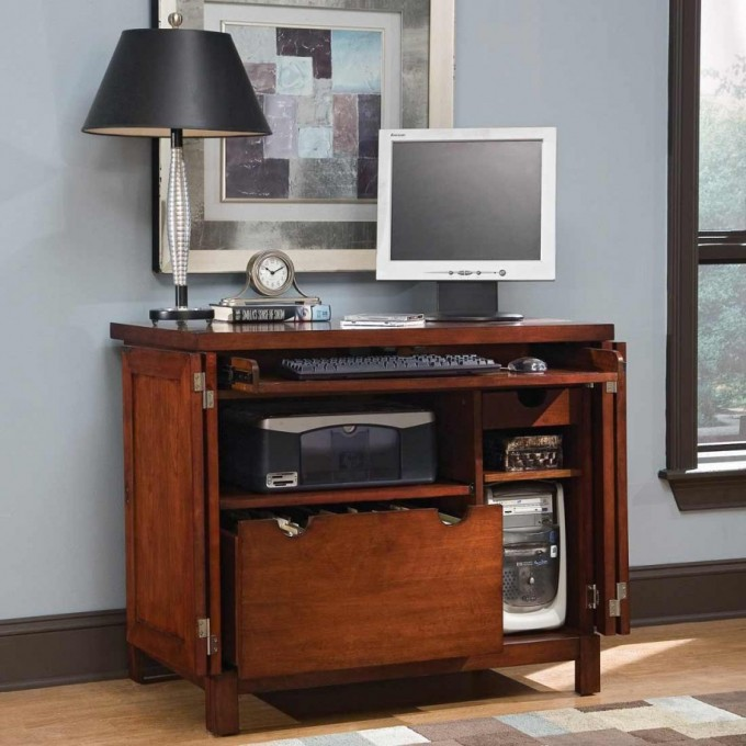 Modest Brown Wooden Computer Armoire With Some Drawers To Keep Computer Equipments Plus Black Table Standing