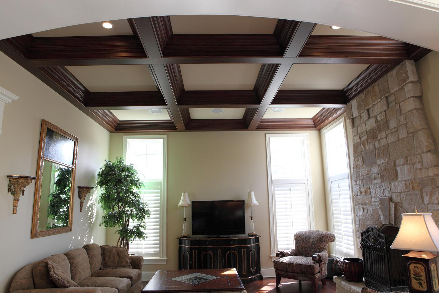 natural brown wood and white Coffered Ceiling matched with white wall plustriple window and tv plus table standing lamp