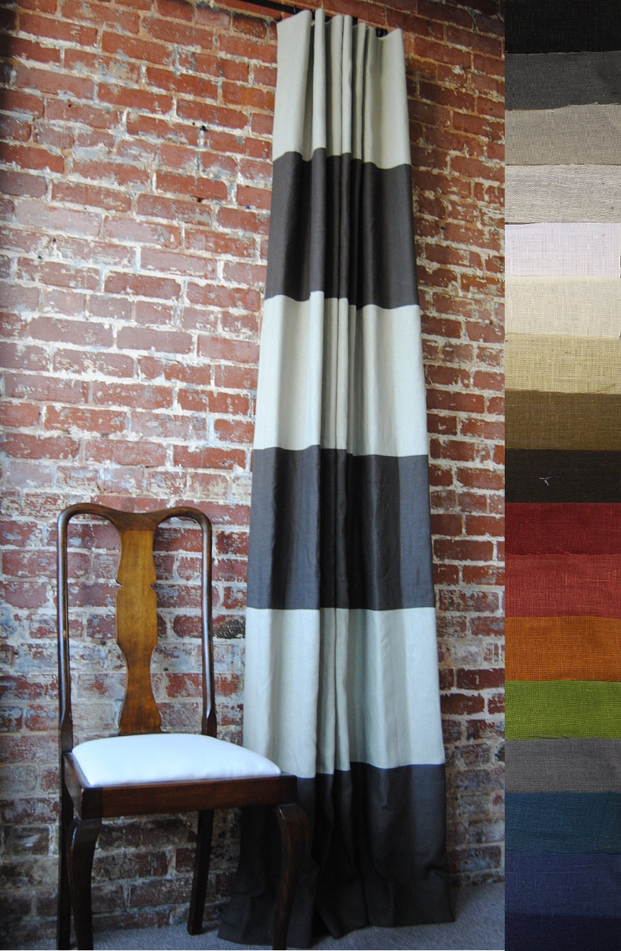 navy horizontal striped curtains with vintage wooden side chair and old brick interior