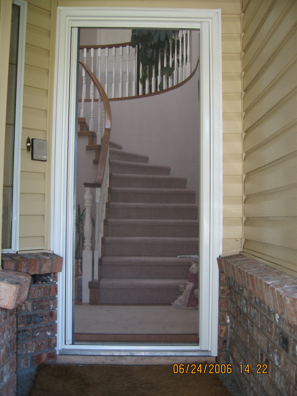 Omnifine Retractable Screen doors with stairs and cream wood wall