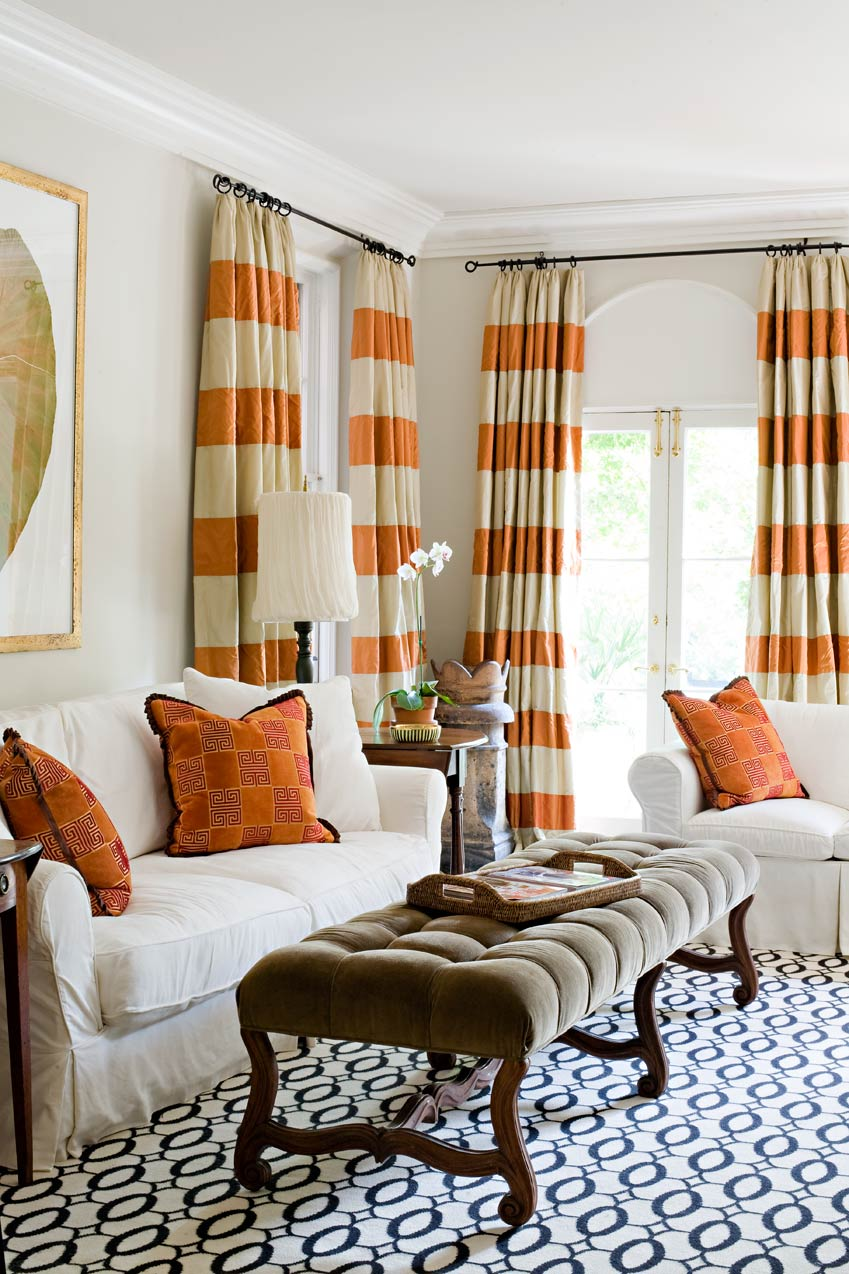 orange and wheat horizontal striped curtains matched with arch window with white sofa orange pillow and