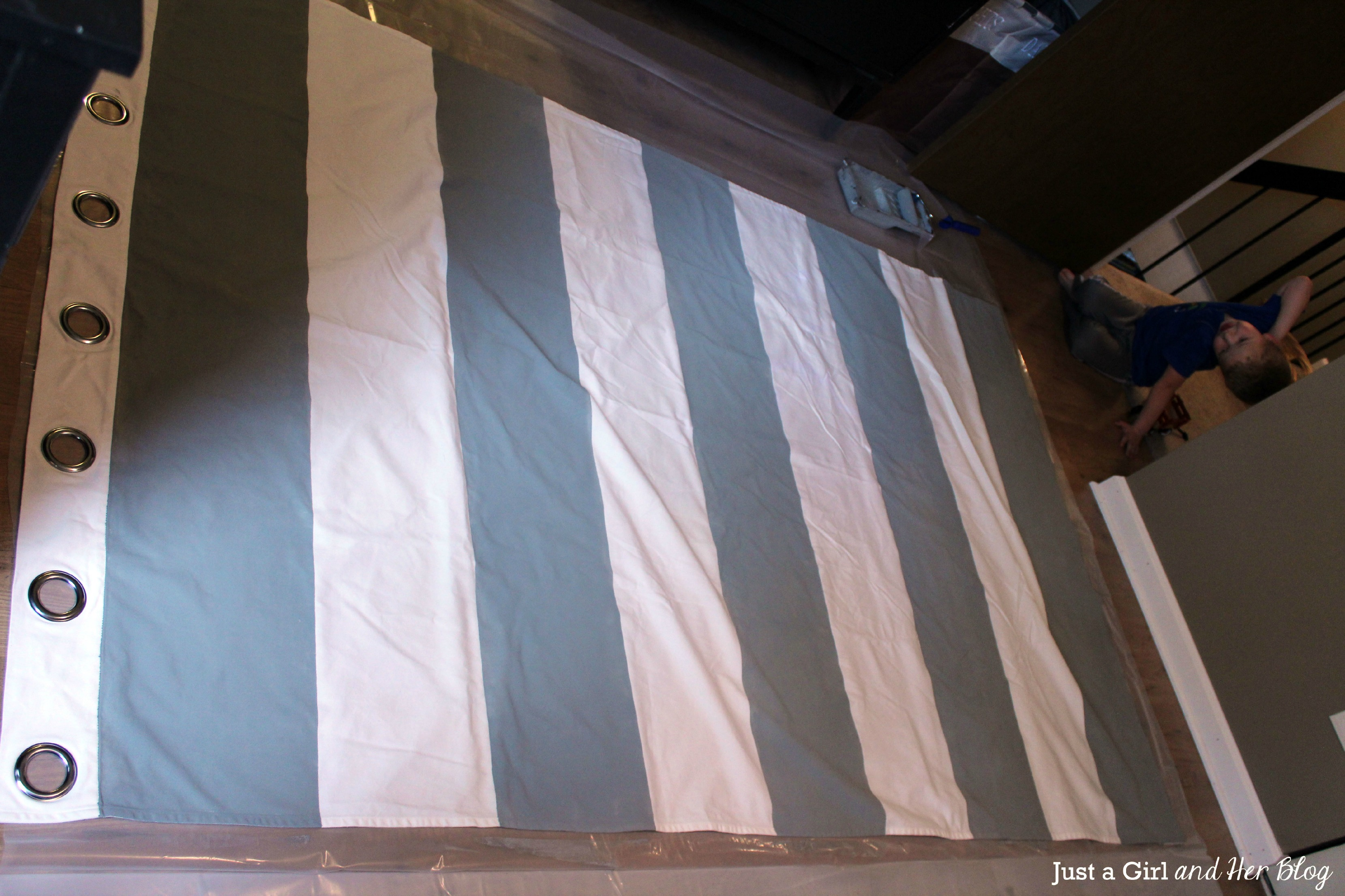 painted horizontal striped curtains on the floor