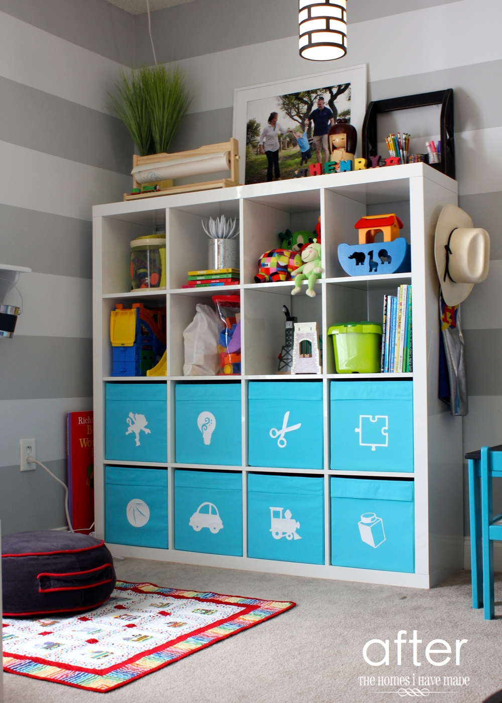 pretty ikea toy storage in white and blue nuance filled with kids goods and frame above with horizontal grey and white horizontal stripped wall