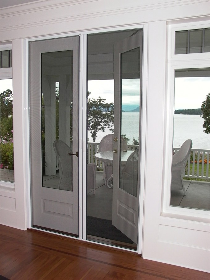 Retractable Screen Doors In White Theme With Double Glass Window