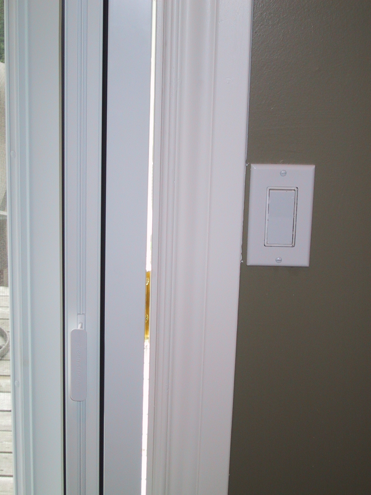Retractable screen doors matched with tan wall and white white handle