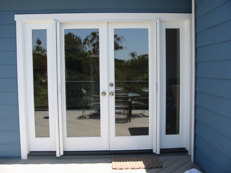 Retractable Screen Doors with blue wall and silver handle