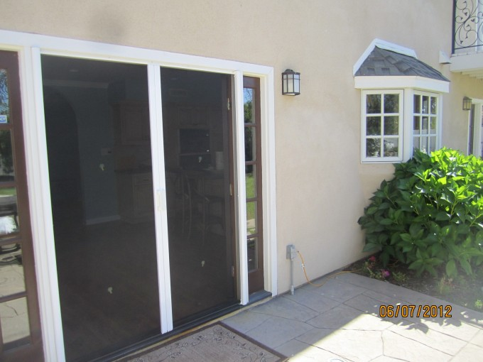 Retractable Screen Doors With Castle Window And Cream Wall