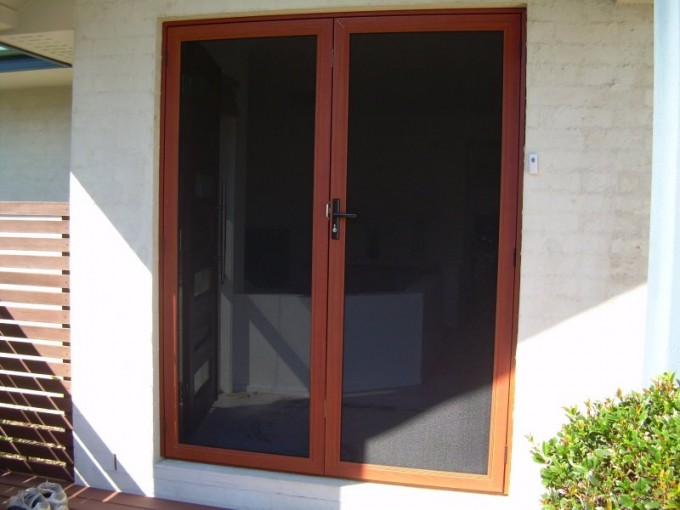 Retractable Screen Doors With Double Stainless Steel Securuty Matched With White Wall