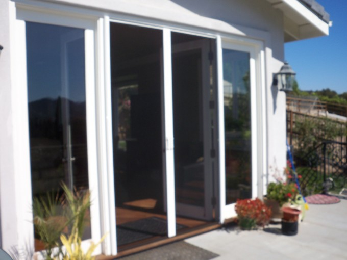Retractable Screen Doors With Flowers And Doormat