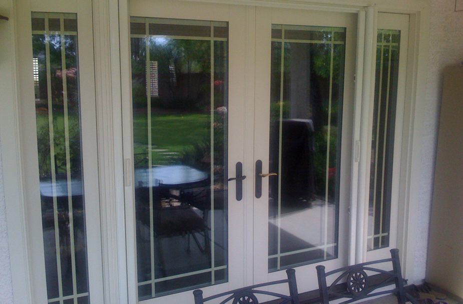 Retractable Screen Doors with golden handle and chairs