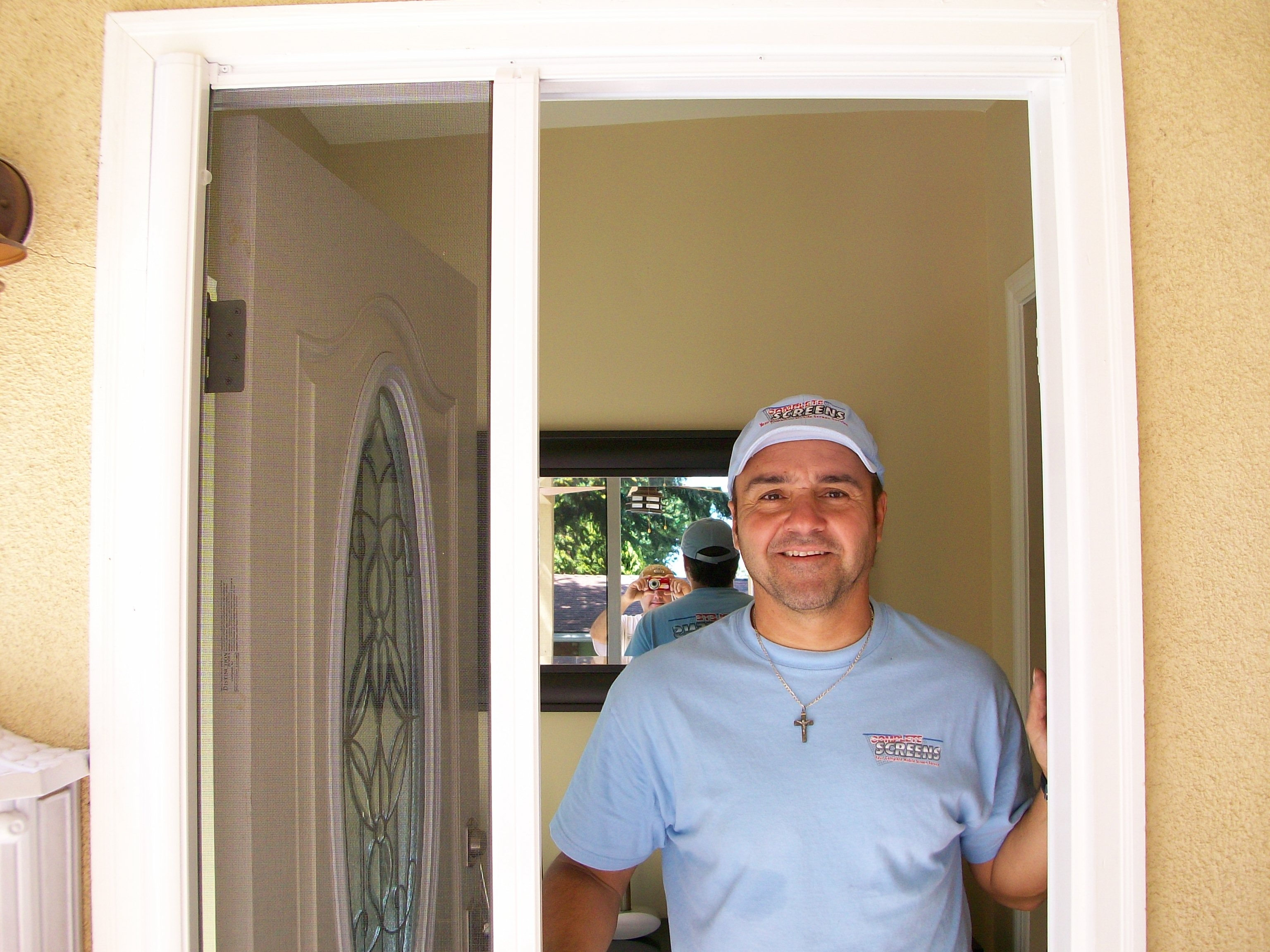 Retractable Screen Doors with ornament on glass and silver handle