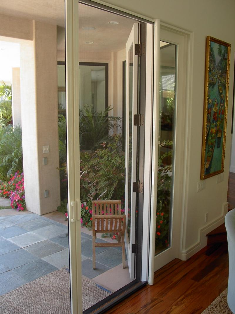 retractable Screen Doors with white wall and wooden floor