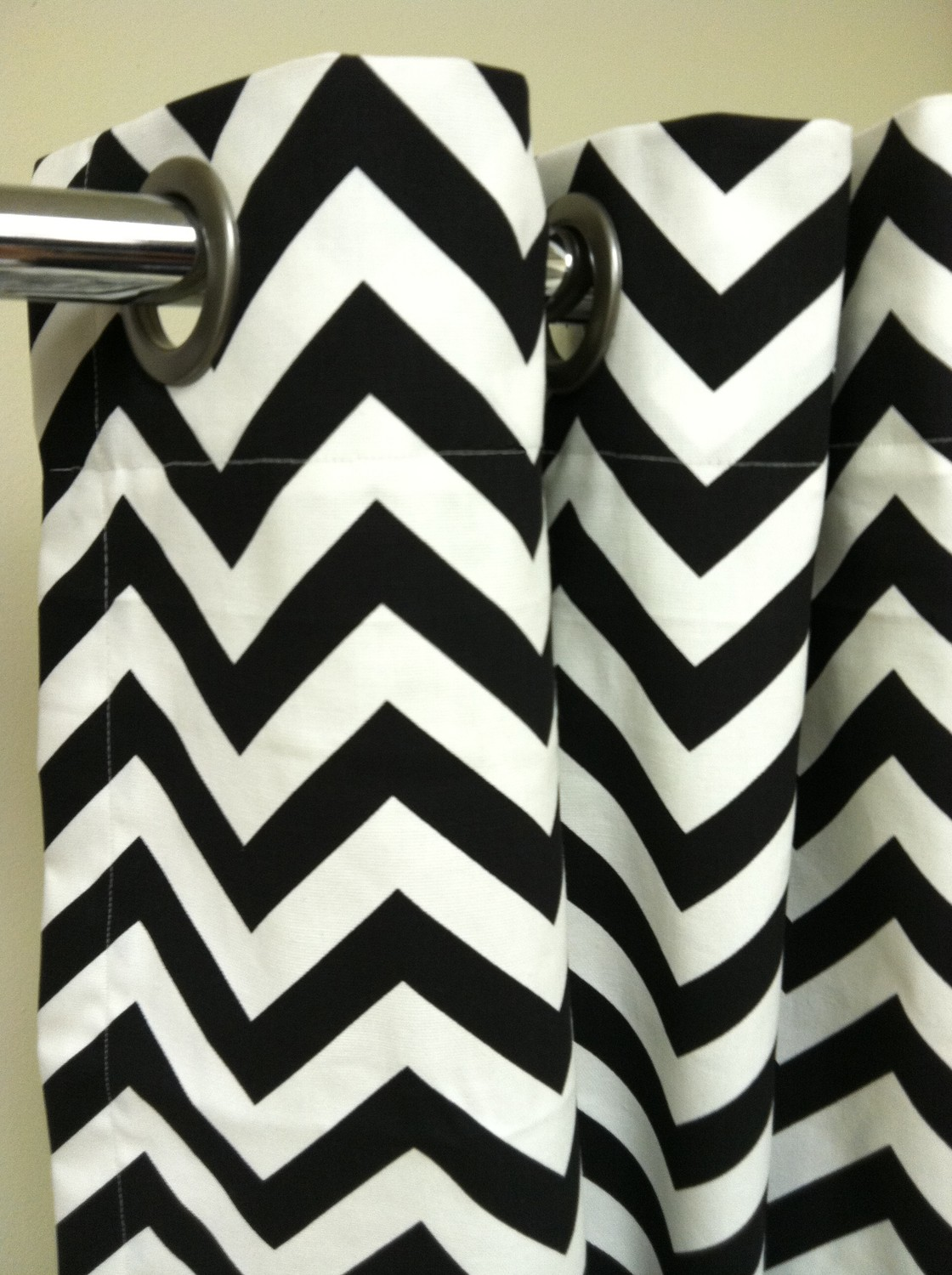 Shower Stall chevron Curtains in black and white with stainless steel finial