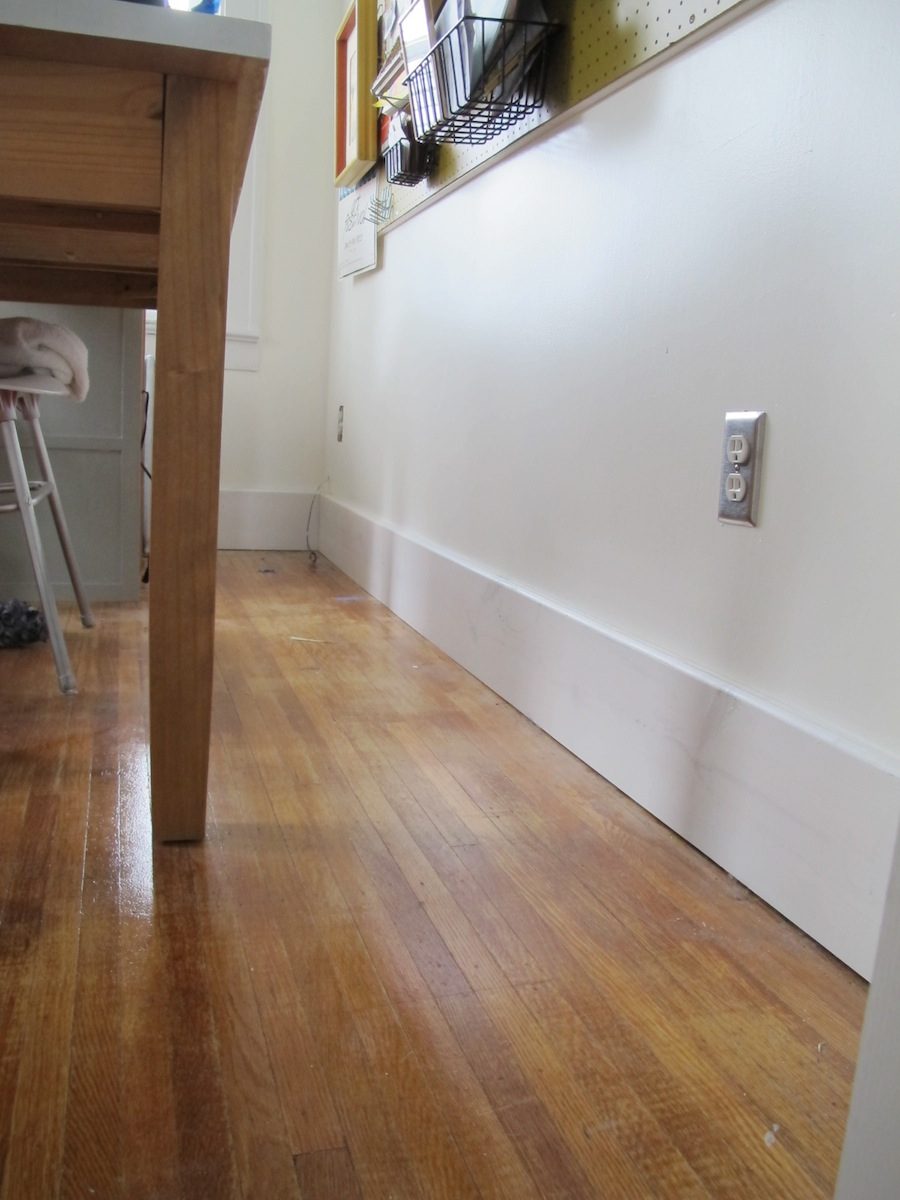 simple baseboard molding with white floor still good
