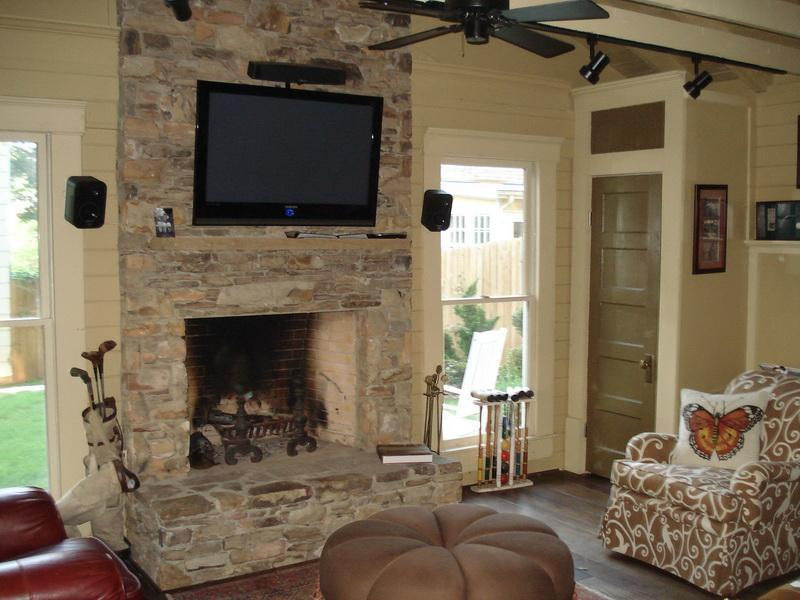 stone veneer panels for wall with sofa and fireplace
