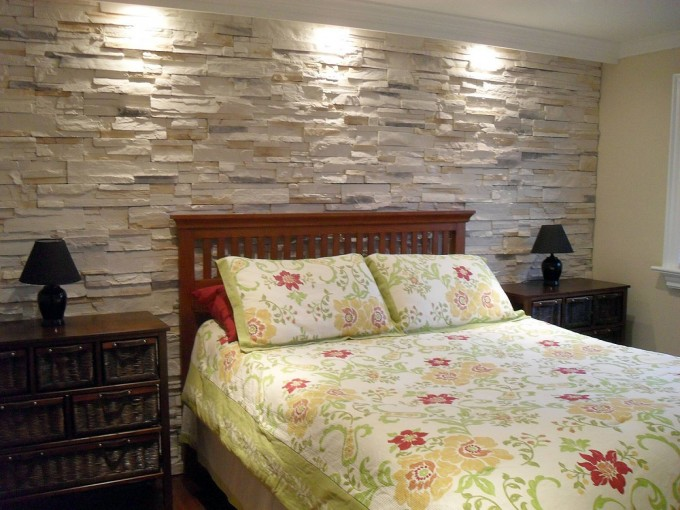 Stone Veneer Panels Matched With White Ceiling With Floral Bedding And Wooden Floor