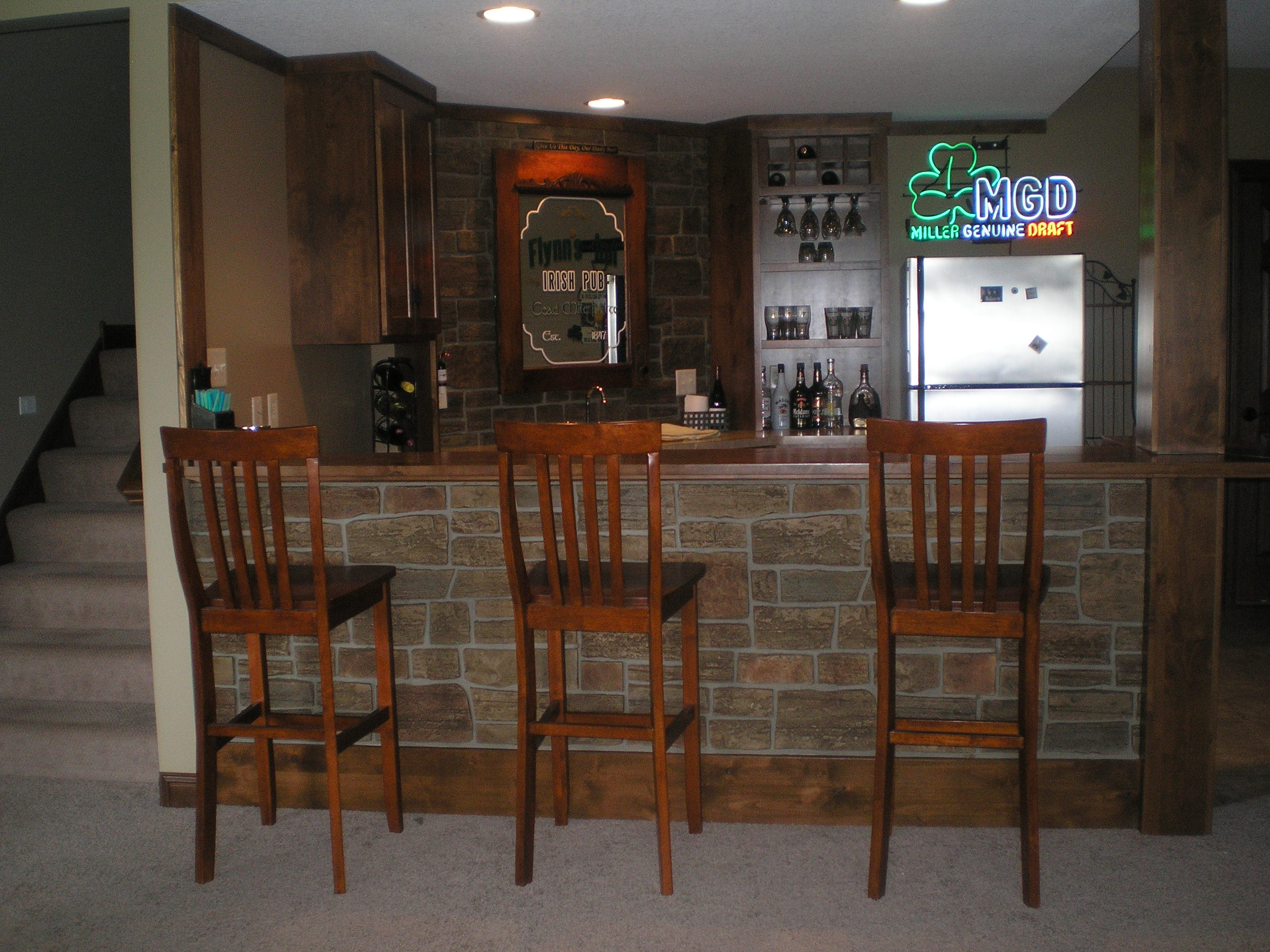 Stone Veneer panels with wooden chair and frige for kitchen ideas