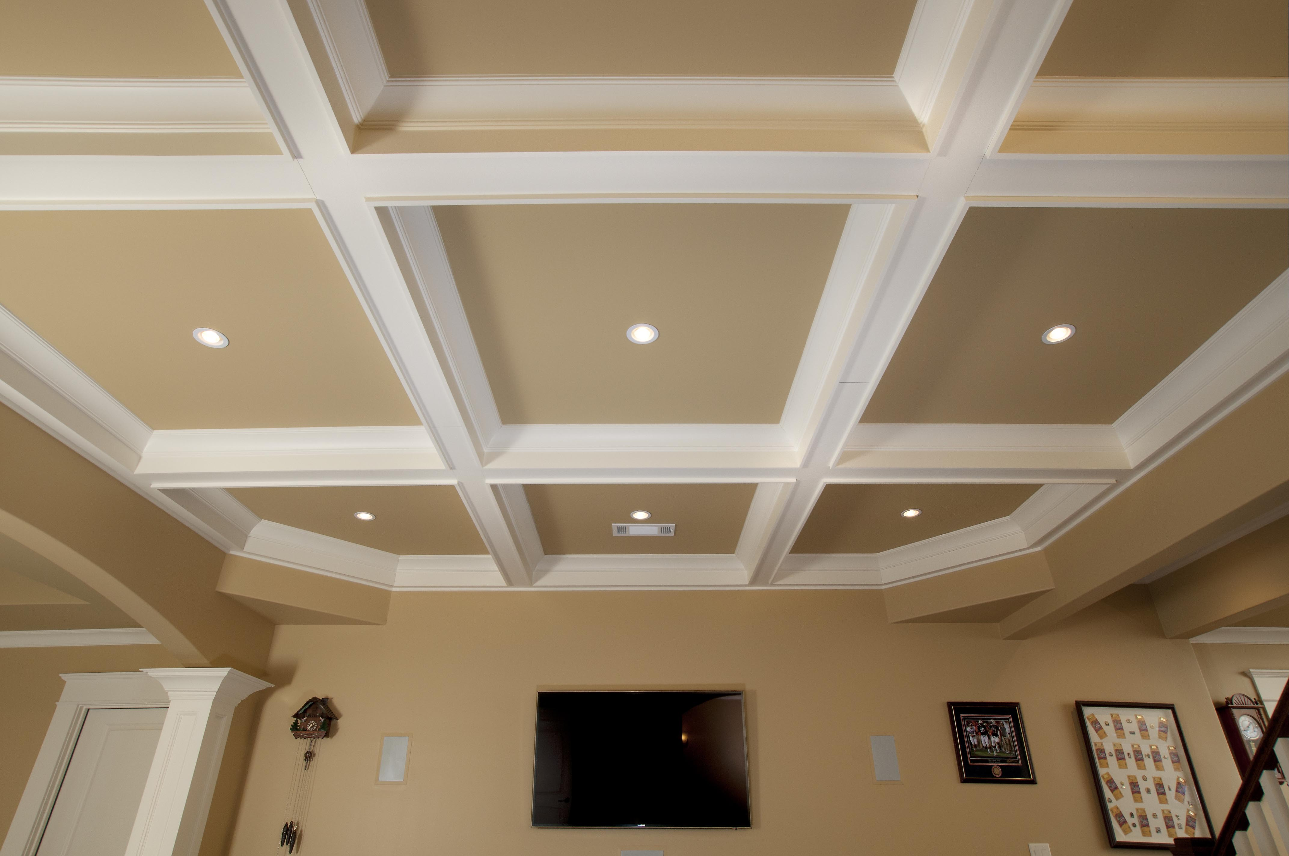 stunning coffered ceiling in white and tan with lights combained with cream wall plus LCD TV on wall
