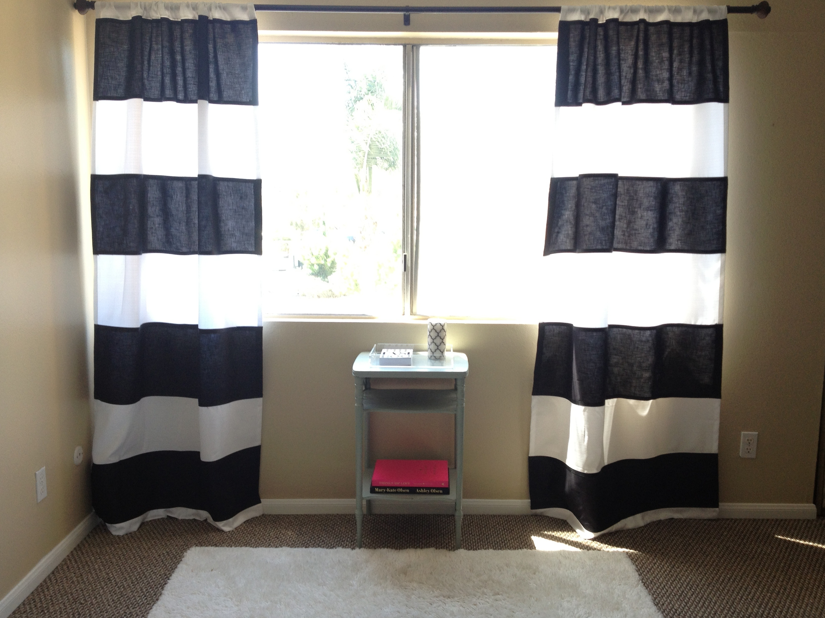 sunbrella Striped Curtains Horizontal in white and black with mini table before window
