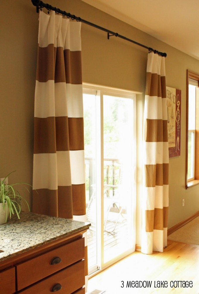 Tan And White Horizontal Striped Curtains Matched With Glass Door And Picture Beside